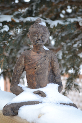 Smiling Buddha under a blanket of snow ©Anna Hergert 2012