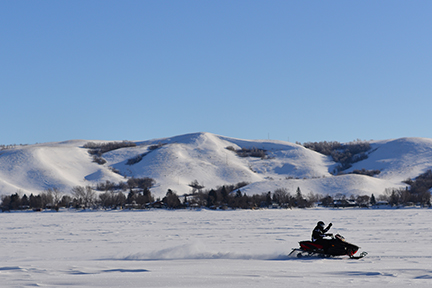 A lone snowmobile rider enjoys his early morning ride. A great way to start Sunday.