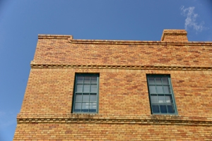 A detail of the refurbished bunkhouse draws the eye high into the sky. Horizontal lines dominate the upper story.
