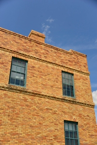 Another detail of the bunkhouse where the line leads the eye across the second story. Note the variation of scale with the large rectangle that frames the window, which is divided into smaller rectangular panes.