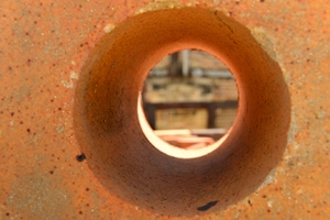 A large brick with a perfect hole, a circle within the circle!
