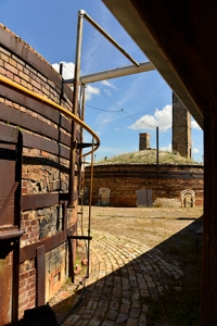 Another view of the kilns from the main brick plant building. The rhythmical stomping of the machinery behind me makes the plant come alive for another day.