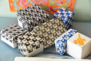 Pat created a variety of patterns, reduced them in size and fashioned a collection of gift boxes.