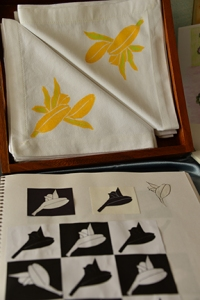 Pat created a stamp by stylizing a lily bud. She used textile paints to stamp the design on a set of cotton napkins.