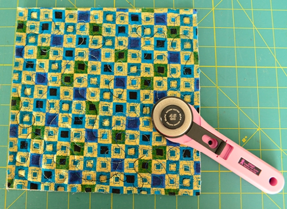 Step 1: Sandwich and quilt your piece. Trim off all loose threads.
