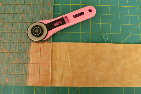 "Step 3: Cut a length of fabric or canvas. Since this sample is relatively small I cut my strip 4 "" wide for the length of the the fabric. For a larger piece I might cut 5 - 6 "" wide and proceed as following."