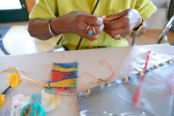 There are no idle hands in this group. Marilyn is spending the last morning embroidering more miniature fabric collages and pendents. Her work was so popular during Tuesday night's mini mall that she is busy creating more.