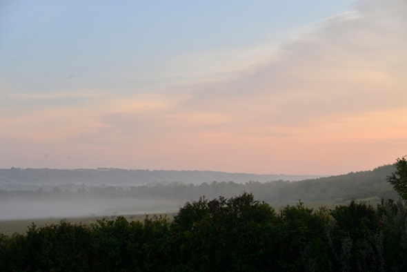 Each morning the meadows are shrouded in mist, the sun's angle paints the sky with pastel color.
