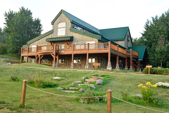 The Timber Lodge (at 5: 30 a. m. ), a picture of serenity and hospitality. Several particpants were already working in the main hall while others caught another forty winks.