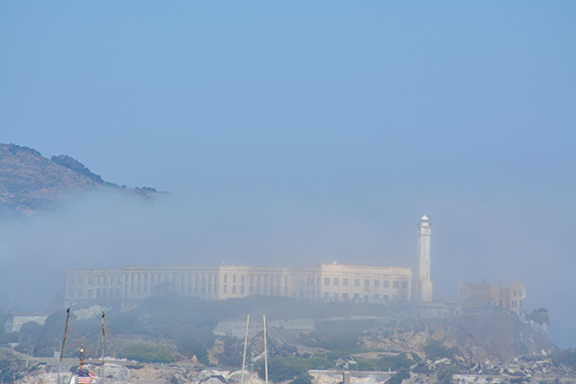 Alcatraz shrouded in mystery and revealing itself as the morning fog burns off.