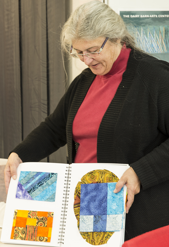 Lynn's inspirational source came from Georgia O'Keefe and the way she depicted flowers. As a result Lynn did not embrace the black and white exercises but ventured into strong color work. She brought not only her samples and sketches but had several luscious woven scarves and quilted table runners for this sharing session. Her final presentation piece is well under way. All I will share here - it is a 3 D piece that will leave no doubt about what and who the inspiration was.