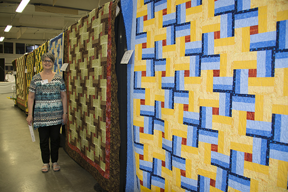 Colleen Sproat gave me a tour of the show just before it opened. It is great to have friends in local guilds... This row of quilts resulted from Colleen's mystery quilt workshop. Isn't it fabulous?