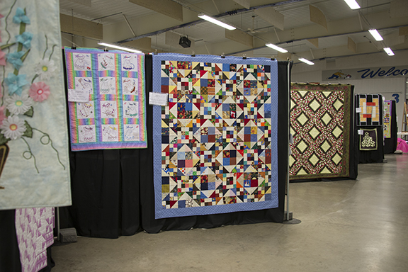 Color and pattern everywhere. There are no ribbons - as it is a non-judged quilt show. There was a viewer's choice ballot that ever one received. The quilt with the most votes will receive a CQA/ACC rosette at the end of today. 162 quilts were on display. On average each quilt member