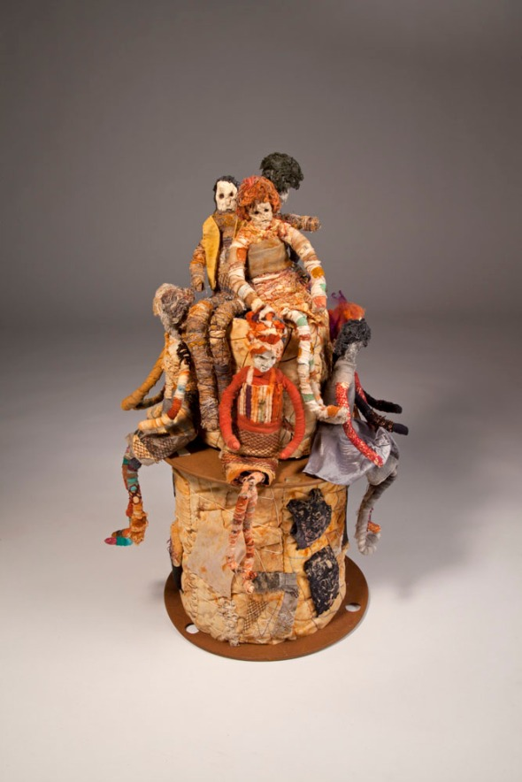 "Scrapyard Couture by Joanne Young, 2011, 14""x14""x22"". Assorted fabrics, nets, meshes, paper pulp, wire. Wrapped, hand stitched."