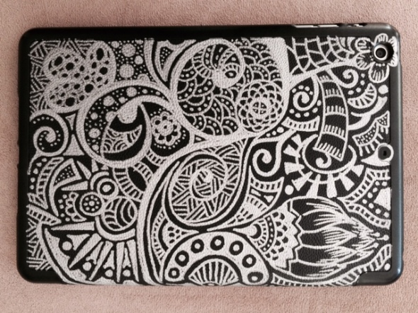 Step 3:...make your mark! Doodle to your heart's content and see how the boring black background transforms into something you love to carry around and handle on a daily basis! This is the top that flips up and houses my iPad mini.
