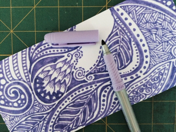 I carefully measured a strip of paper to cover the outer circumference without any overlap. Then I selected the color (I decided on a mauve to complement the pale yellow of the container) and began my doodles, mark making, line study - whatever you want to call it.