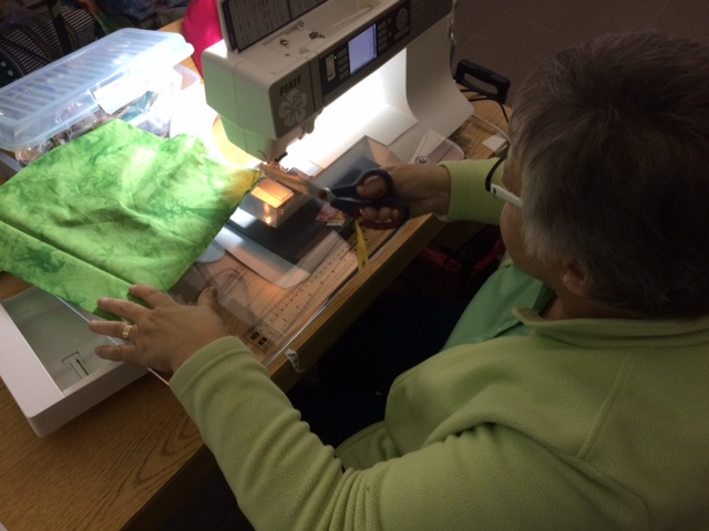 Linda is piecing her back ground using her own hand dyed fabrics.