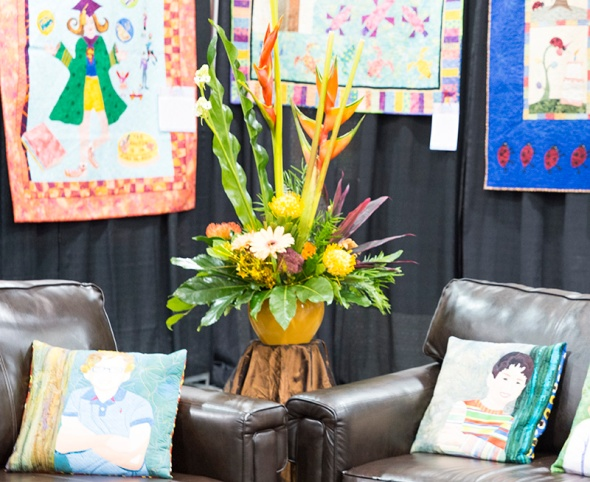 Gillian's custom arrangement created by Debbie and Terry brightens up the exhibition space even more!